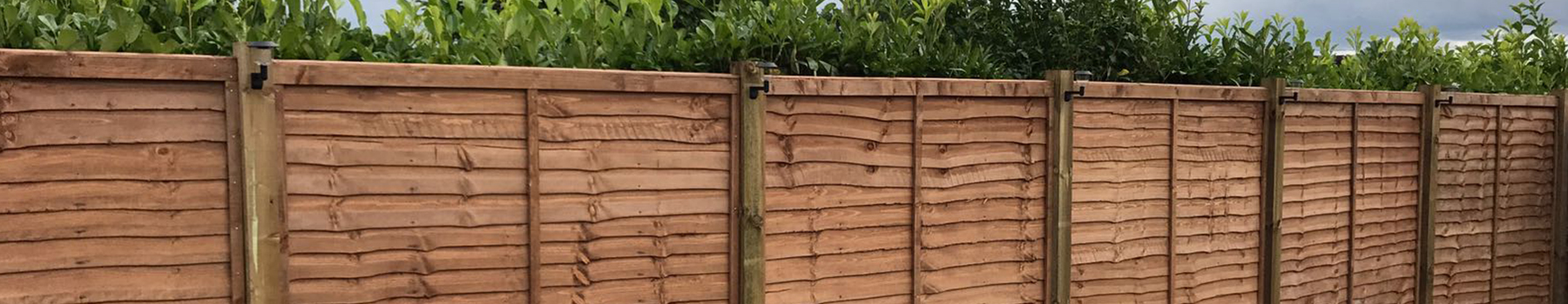 As you local fencing company, BN Fencing installed this larch lap fence
